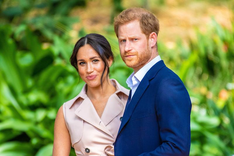 Prince Harry and Meghan Markle are pictured.