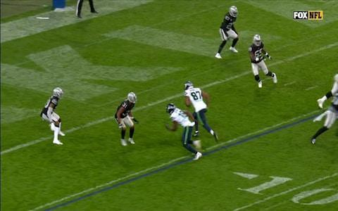 <span>Those two Seahawks runners hit the end zone: one goes left, the other (Brown) goes right</span> <span>Credit: BBC </span>