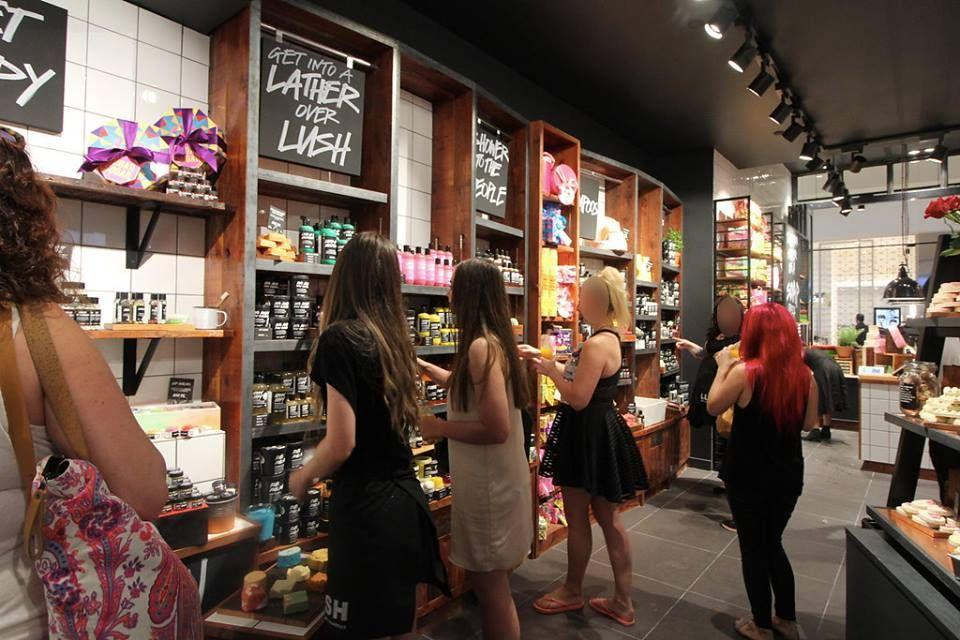 Shoppers in an Australian Lush store are pictured standing in front of a stand of 'Snow Fairy' body washes. Source: Facebook/Lush