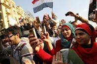 Egyptians use their mobile phones to record celebrations on February 12, 2011 in Cairo's Tahrir Square