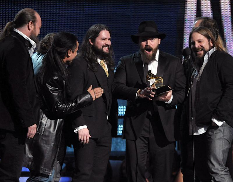 """Zac Brown, center, of the musical group Zac Brown Band accepts the award for best country album """"Uncaged"""" at the 55th annual Grammy Awards on Sunday, Feb. 10, 2013, in Los Angeles. (Photo by John Shearer/Invision/AP)"""