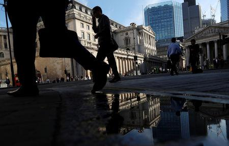 FILE PHOTO: People walk past the Bank of England in London, Britain. Aug 24, 2018. REUTERS/Simon Dawson
