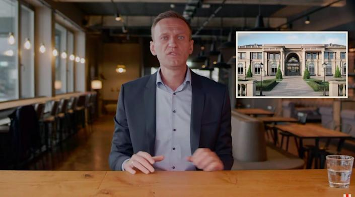 Alexei Navalny seen in a video alongside a rendering of what he says is Vladimir Putin's secret palace on the Black Sea.