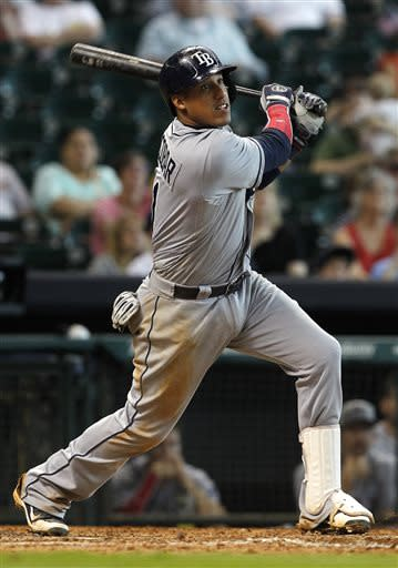 Tampa Bay Rays' Yunel Escobar hits a line drive into right field for a double, scoring teammate Jose Lobaton, during the eleventh inning of a baseball game against the Houston Astros, Thursday, July 4, 2013, in Houston. The Rays defeated the Astros 7-5. (AP Photo/Patric Schneider)