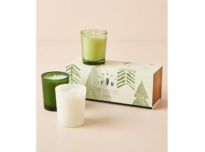 "<p>Tasteful and timeless festiveness. What's not to love?</p> <p><a class=""cta-button-link"" href=""https://www.anthropologie.com/shop/frost-and-fir-votives-gift-set-set-of-3"" target=""_blank"">Buy It (from $38)</a></p>"