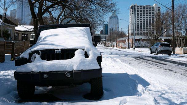 PHOTO: A parked Jeep is covered in snow Tuesday, Feb. 16, 2021, in Austin, Texas. Temperatures dropped into the single digits as snow shut down air travel and grocery stores. (Ashley Landis/AP)