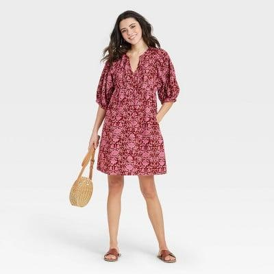 <p>Pair this <span>Universal Thread Puff Elbow Sleeve Babydoll Dress</span> ($25) with slide sandals for a polished, easygoing look.</p>