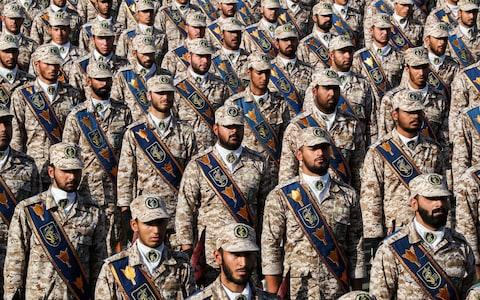 "Members of Iran's Islamic Revolutionary Guard Corps (IRGC) standing in formation during the annual ""Sacred Defence Week"" - Credit: AFP"