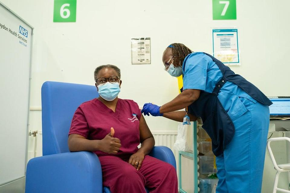 A Covid-19 booster jab is administered at Croydon University Hospital, south London (Dominic Lipinski/PA) (PA Wire)