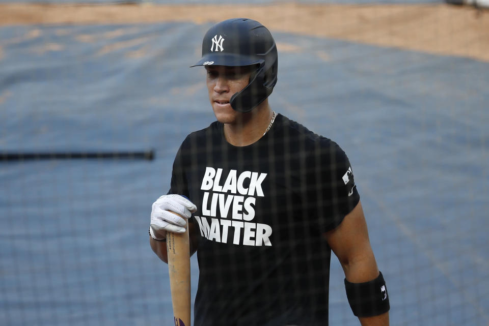 """New York Yankees right fielder Aaron Judge (99), wearing a """"Black Lives Matter"""" shirt during team batting practice before the start of opening day baseball game against the Washington Nationals at Nationals Park, Thursday, July 23, 2020, in Washington. (AP Photo/Alex Brandon)"""