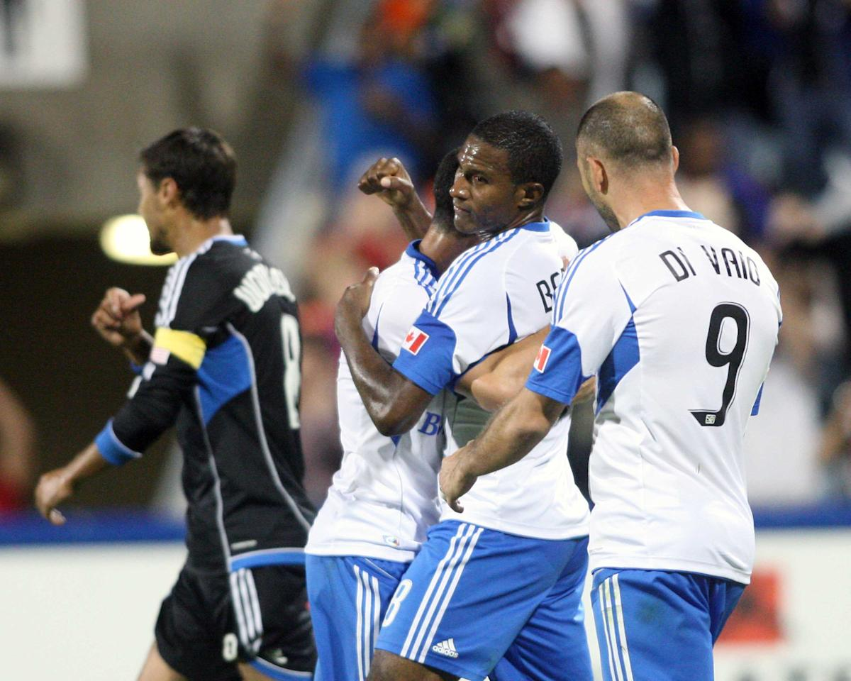 MONTREAL, CANADA - AUGUST 18:  Patrice Bernier #8 of the Montreal Impact celebrates his penalty kick goal with teammates during the match against the San Jose Earthquakes at the Saputo Stadium on August 18, 2012 in Montreal, Quebec, Canada.  The Impact defeated the Earthquakes 3-1.  (Photo by Richard Wolowicz/Getty Images)
