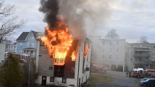 Firefighters responded to a blaze at an apartment building in Saint John's north end on Friday. (Submitted by Doug Epton SJNC - image credit)
