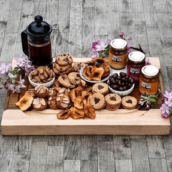 """Be the bearer of winter treats with this curated care package that includes a mix of organic jams, cookies, and teas from Frog Hollow Farm. It's (quite literally) the sweetest way to say """"I love you."""" $85, Frog Hollow Farm. <a href=""""https://www.froghollow.com/collections/holiday-gifts/products/taste-master-box"""" rel=""""nofollow noopener"""" target=""""_blank"""" data-ylk=""""slk:Get it now!"""" class=""""link rapid-noclick-resp"""">Get it now!</a>"""