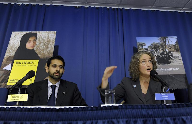 Letta Tayler, senior counterterrorism researcher at Human Rights Watch, right, accompanied by Mustafa Qadri, a Pakistan researcher at Amnesty International, talks about the findings of two new reports, by Amnesty International and Human Rights Watch on US drone strikes and other air strikes in Pakistan and Yemen, Tuesday, Oct. 22, 2013, during a news conference at the National Press Club in Washington. (AP Photo/Susan Walsh)