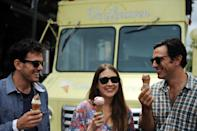 In this Tuesday, July 31, 2012, photo, from left, Van Leeuwen Artisan Ice Cream co-owners Ben Van Leeuwen, Laura O'Neill and Pete Van Leeuwen laugh while talking about the origins of their business while eating ice cream in front of one of their trucks on Bedford Avenue in the Williamsburg section of New York's Brooklyn borough. Food trucks have been around for generations but have flourished in a weak economy because consumers are looking for an inexpensive meal that's not just a hot dog and soda. Or they're looking for a treat like cupcakes and ice cream that are different than what they'd find in a supermarket. For Van Leeuwen Artisan Ice Cream, the six yellow trucks that began selling cones and sundaes four years ago have led to the opening of three stores. (AP Photo/Jeffrey Furticella)