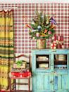 "<p>Nestled in a minnow bucket, a small tree with pennants and arrows tucked in reinforces the camp vibe of <a href=""https://www.countryliving.com/home-design/house-tours/g3857/christmas-camp-decorating-ideas/"" rel=""nofollow noopener"" target=""_blank"" data-ylk=""slk:this California cabin"" class=""link rapid-noclick-resp"">this California cabin</a>. (Archery, anyone?)</p><p><strong><a class=""link rapid-noclick-resp"" href=""https://go.redirectingat.com?id=74968X1596630&url=https%3A%2F%2Fwww.etsy.com%2Fsearch%3Fq%3Dminnow%2Bbucket&sref=https%3A%2F%2Fwww.countryliving.com%2Fhome-design%2Fdecorating-ideas%2Fadvice%2Fg1247%2Fholiday-decorating-1208%2F"" rel=""nofollow noopener"" target=""_blank"" data-ylk=""slk:SHOP MINNOW BUCKETS"">SHOP MINNOW BUCKETS</a></strong></p>"