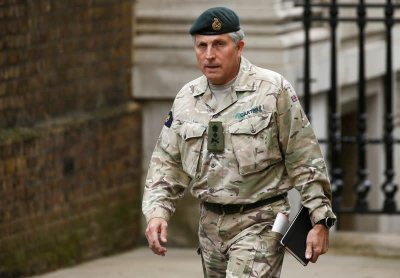 British Army General Sir Nick Carter arrives for a meeting to address the government's response to the coronavirus outbreak, at Downing Street in London