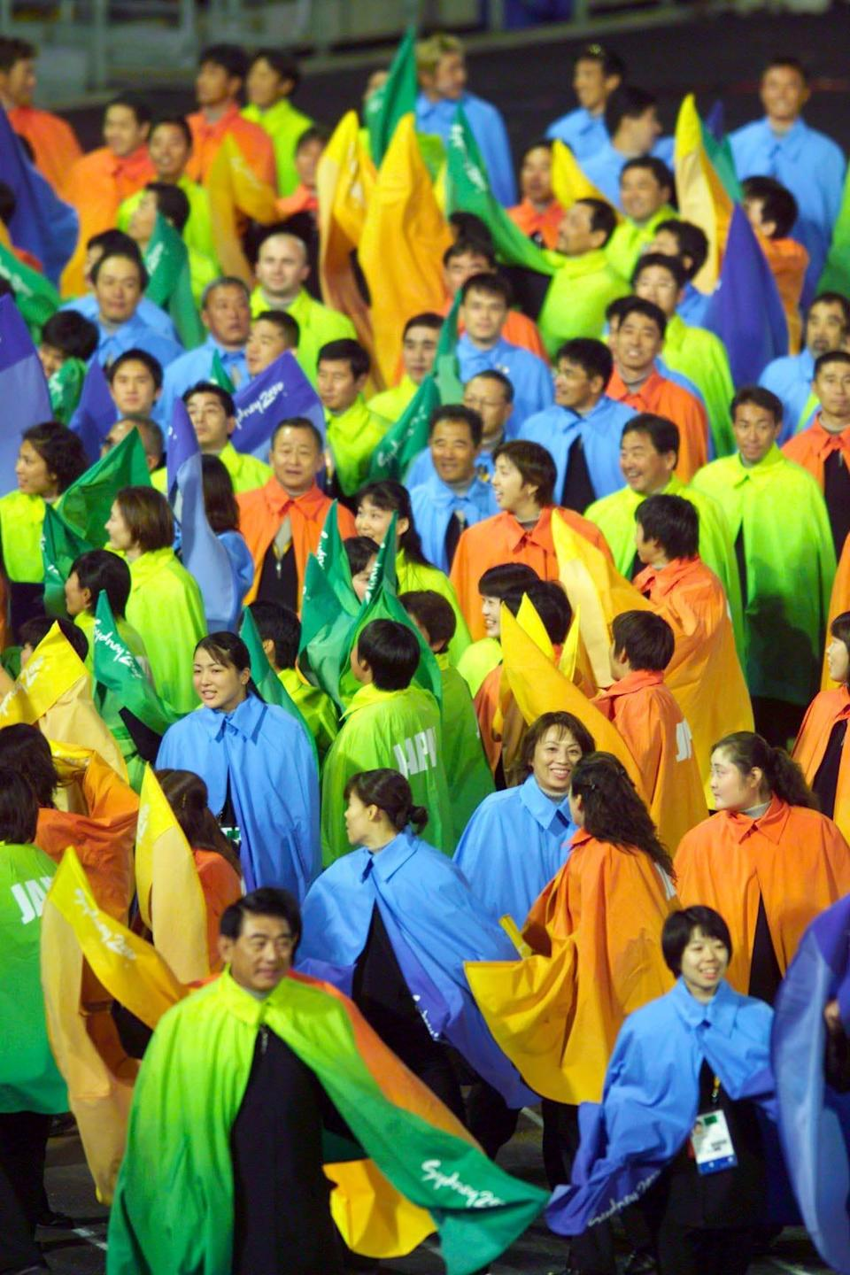 japan's olympic team in 2000 dressed in colorful capes