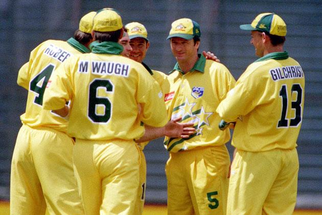 Australia's Steve Waugh is congratulated by Gavin Robertson, Mark Waugh and Adam rGilchrist after catching New Zealand's Chris Cairns for 2 during the one day international at Eden Park,Saturday.  (Photo by Ross Land/Getty Images)
