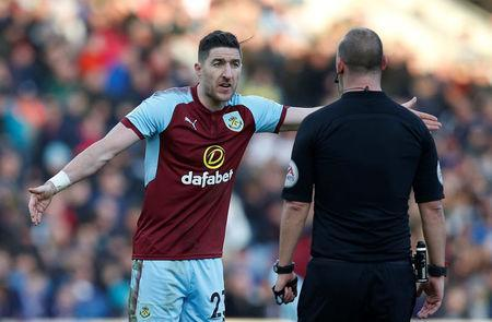 Soccer Football - Premier League - Burnley vs Southampton - Turf Moor, Burnley, Britain - February 24, 2018 Burnley's Stephen Ward appeals to referee Robert Madley REUTERS/Andrew Yates
