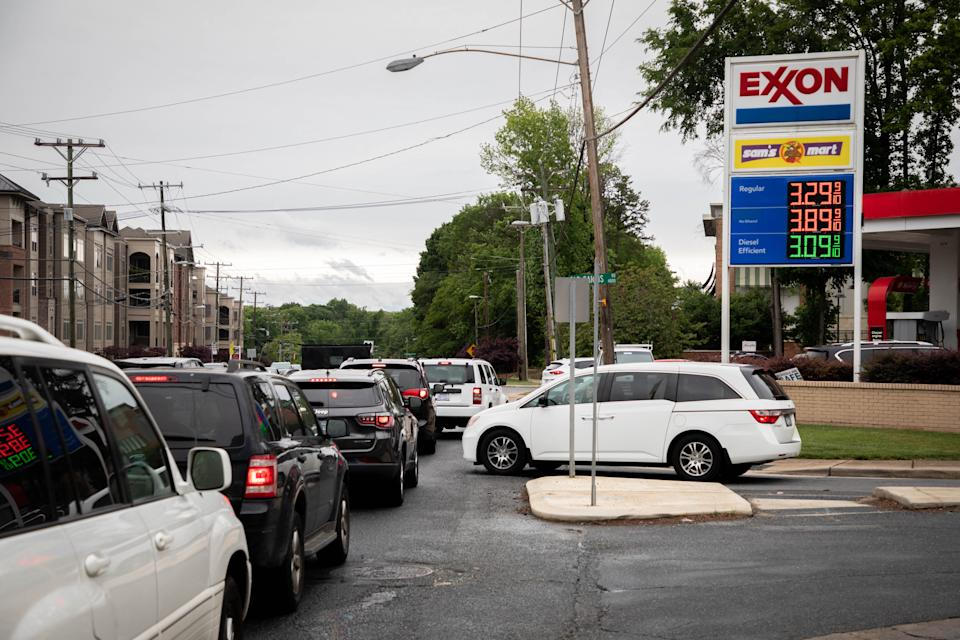 Motorists line up at an EXXON station selling gas at $3.29 per gallon soon after it's fuel supply was replenished in Charlotte, North Carolina on May 12, 2021. - Fears the shutdown of the Colonial Pipeline because of a cyberattack would cause a gasoline shortage led to some panic buying and prompted US regulators on May 11, 2021 to temporarily suspend clean fuel requirements. While it remained unclear the degree to which supplies would be affected, drivers lined up to fill their tanks at gas stations in the southeast, with some carrying extra containers amid fears of fuel scarcity. (Photo by Logan Cyrus / AFP) (Photo by LOGAN CYRUS/AFP via Getty Images)