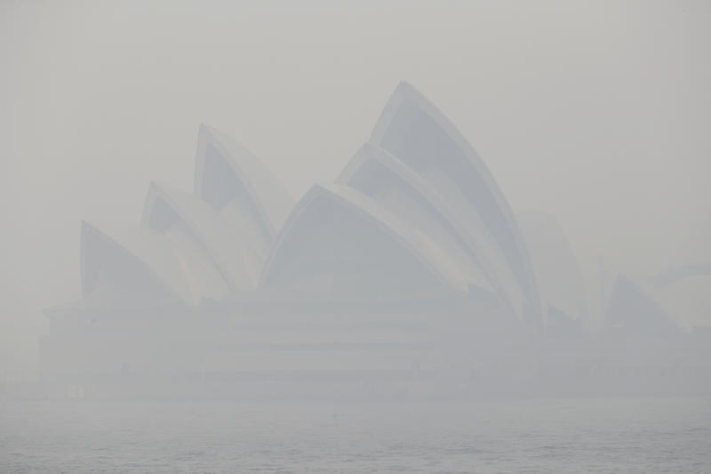 Thick smoke from wildfires shroud the Opera House in Sydney, Australia, Tuesday, Dec. 10, 2019. Hot dry conditions have brought an early start to the fire season. (AP Photo/Rick Rycroft)