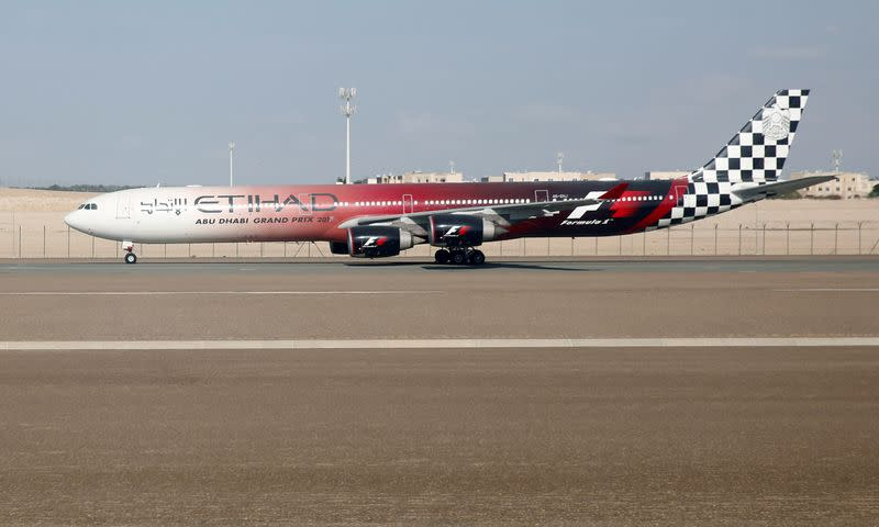 FILE PHOTO: Etihad Airways Airbus A340 plane is seen parked at Abu Dhabi International Airport in United Arab Emirates