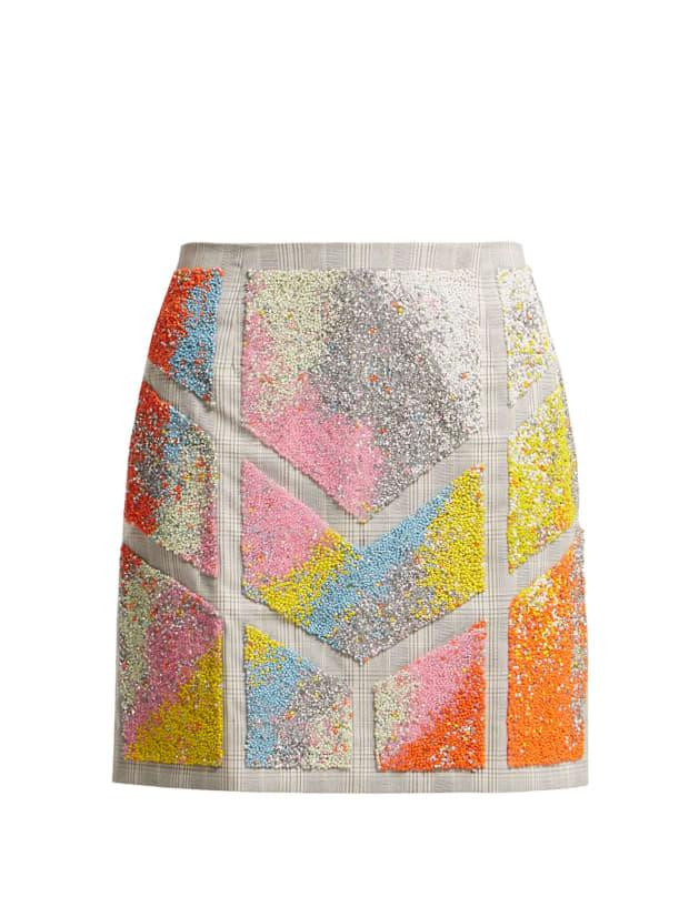 """<p>Germanier Bead-Embellished Twill Mini Skirt, $319, <a href=""""https://rstyle.me/+MLWKIxiXIJ8d42tQ-tTnIw"""" rel=""""nofollow noopener"""" target=""""_blank"""" data-ylk=""""slk:available here"""" class=""""link rapid-noclick-resp"""">available here</a>.</p>"""