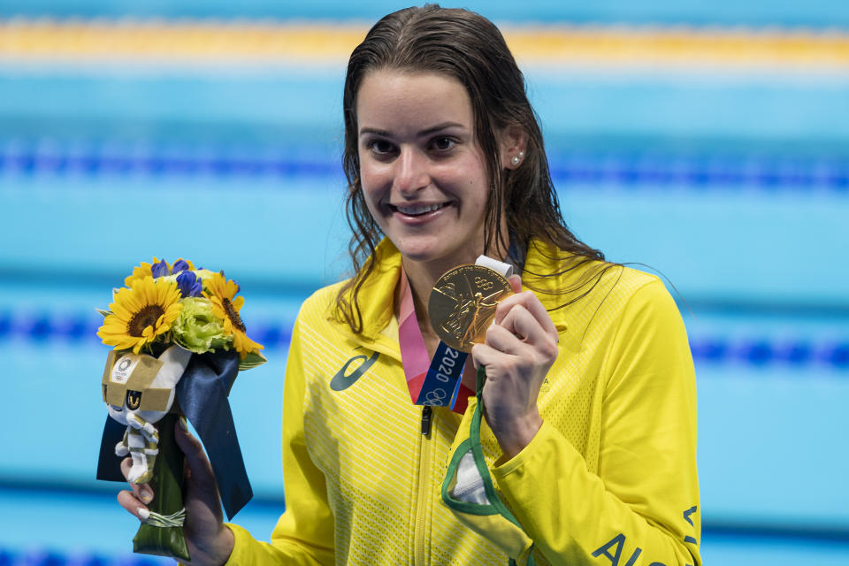 Kaylee Mckeown (pictured) shows her gold medal after winning the women 100m Backstroke final.