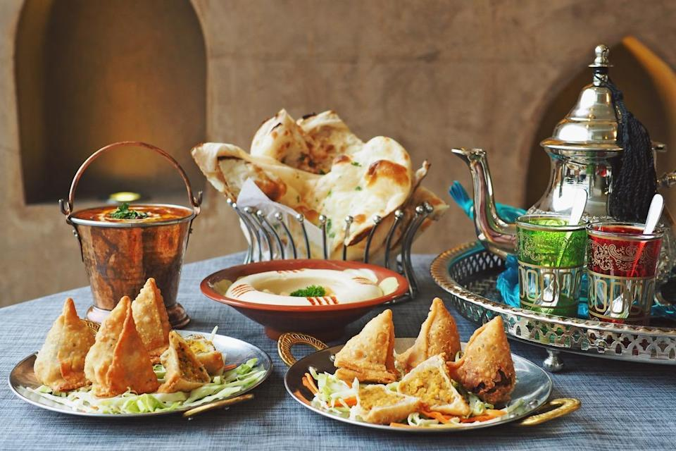 """Dates aside, what you eat for the rest of your sacred break-fast meal—called <em>iftaar</em>—depends on where you live. In India and Pakistan, for instance, fried foods like <em>samosas</em> and <em>pakoras</em> and a fruit salad called <em>fruit chaat</em> are considered typical Ramadan food. Meanwhile, <em>fattoush</em>, a salad made of vegetables and pita, is commonly eaten in Egypt, and Indonesians eat <em>kolak</em>, a fruit dessert made from palm sugar, coconut milk, and pandanus leaf. A few countries over, a Lebanese iftaar will feature a number of main dishes like <em>molokhia</em>, a chicken stew, and <em>mehshi koussa ablama</em>, a stuffed zucchini. And for another holiday to learn more about, check out <a href=""""https://bestlifeonline.com/rosh-hashanah-facts/?utm_source=yahoo-news&utm_medium=feed&utm_campaign=yahoo-feed"""" rel=""""nofollow noopener"""" target=""""_blank"""" data-ylk=""""slk:17 Fascinating Facts About the Jewish New Year"""" class=""""link rapid-noclick-resp"""">17 Fascinating Facts About the Jewish New Year</a>."""