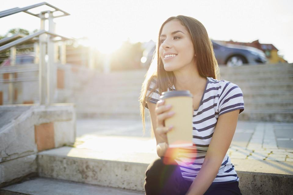 Woman drinking coffee in to-go cup