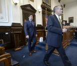 Kyle Rittenhouse, left, walks into the courtroom with attorney Mark Richards for a motion hearing in Kenosha, Wis., on Friday, Sept. 17, 2021. (Sean Krajacic/The Kenosha News via AP)