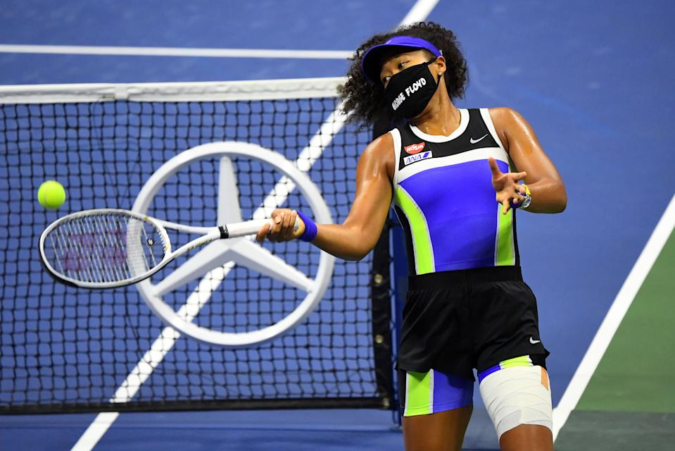 Sep 8, 2020; Flushing Meadows, New York, USA; Naomi Osaka of Japan wearing a George Floyd mask hits balls into the stands after her win against Shelby Rogers of the United States in the womenÕs singles quarter-finals match on day nine of the 2020 U.S. Open tennis tournament at USTA Billie Jean King National Tennis Center. Mandatory Credit: Robert Deutsch-USA TODAY Sports