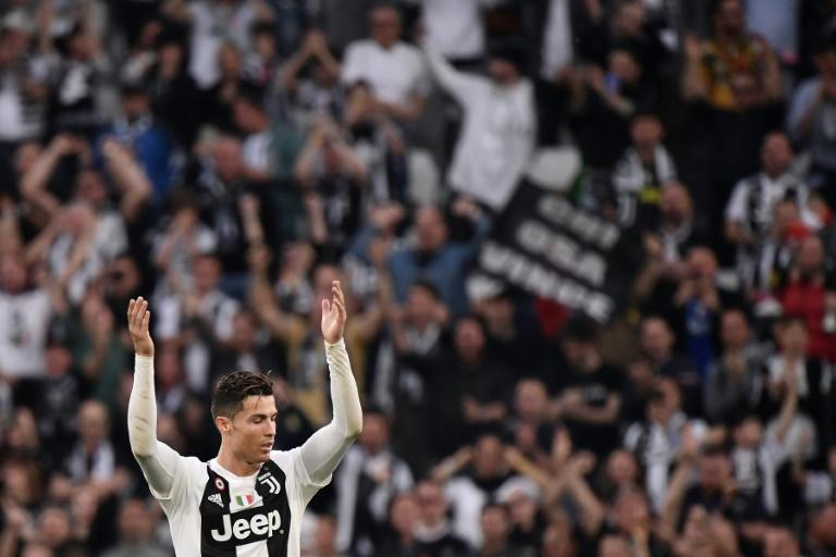 Ronaldo celebrates after Juventus seal their eighth straight title