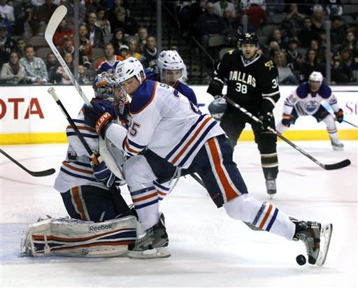Edmonton Oilers defenseman Andy Sutton (25), of Canada, kicks the puck away fro the goal during the first period of a NHL hockey game on Saturday, Jan. 7, 2012, in Dallas. (AP Photo/John F. Rhodes)