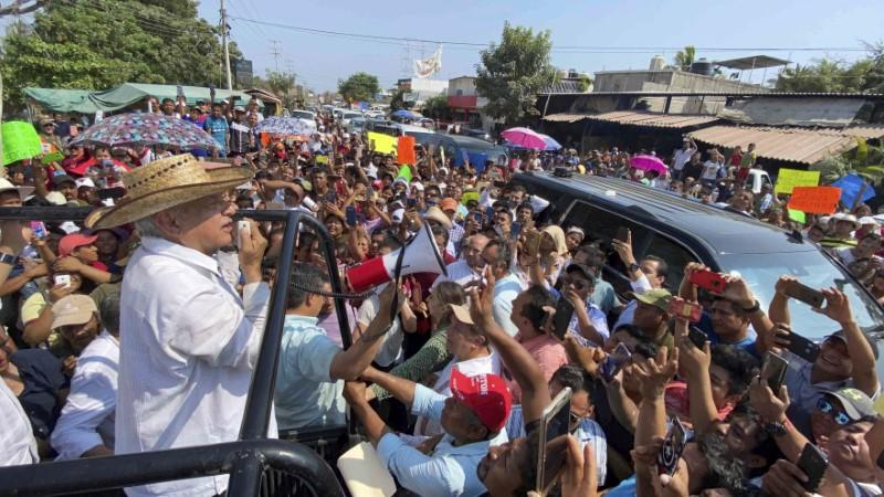 Mexico's President Andres Manuel Lopez Obrador uses a megaphone to talk to supporters during a rally in Ayutla de los Libres