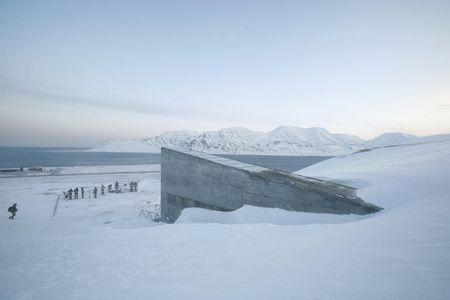 Television crews stand outside the Global Seed Vault before the opening ceremony in Longyearbyen February 26, 2008. REUTERS/Bob Strong