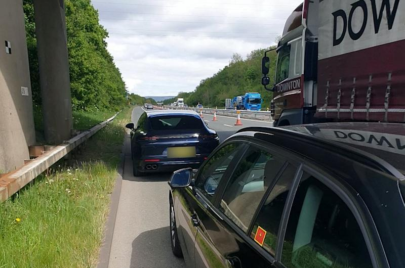 "A ""disgraceful"" Porsche driver was caught speeding past a police car at 144mph - almost triple the speed limit. See SWLEporsche. The motorist, who hasn't been named, was clocked while driving through 50mph zone roadworks on the M65 on Monday (May 11). The officer followed the driver for nine miles between Blackburn and Burnley, Lancs. Posting on Twitter, the road cop said: ""The driver of this Porsche overtook my police car on the M65 at 125mph. ""Speeds reached 144mph as he entered the 50mph roadworks section. Disgraceful speed. ""He has been reported and his day in court awaits. The roads aren't a race track no matter what you drive."""