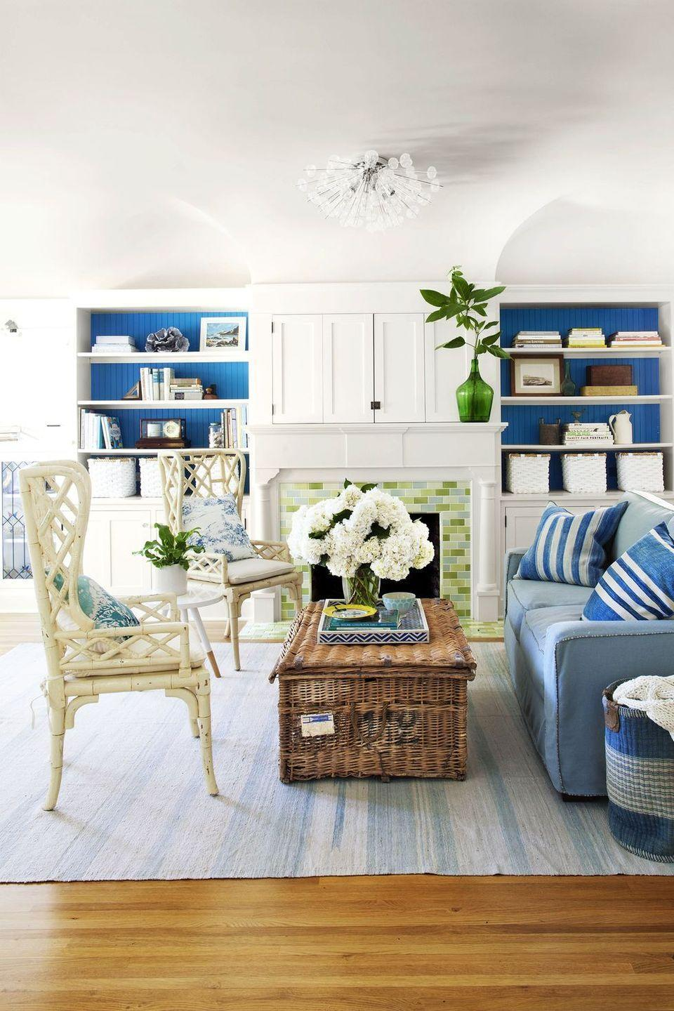 """<p>A bright blue was Pantone's Color of the Year in 2020, and you'll probably continue to see it this year, too. It works particularly well when paired with green, as the colors remind us of the great outdoors. """"Both of these colors are so versatile and can work as an accent wall in a dark tone, as a pop of color in pillows or a rug, or even as a statement sofa in your space,"""" says Lee Mayer, CEO of the online interior design service <a href=""""https://go.redirectingat.com?id=74968X1596630&url=https%3A%2F%2Fhavenly.com%2Finterior-design-ideas&sref=https%3A%2F%2Fwww.redbookmag.com%2Fhome%2Fg35149665%2Fspring-colors%2F"""" rel=""""nofollow noopener"""" target=""""_blank"""" data-ylk=""""slk:Havenly"""" class=""""link rapid-noclick-resp"""">Havenly</a>. """"Depending on the tones and fabrics you choose, both of these colors can play into any style really well — an emerald velvet sofa can feel really luxe while blue linen pillows can feel perfectly classic.""""<br></p>"""