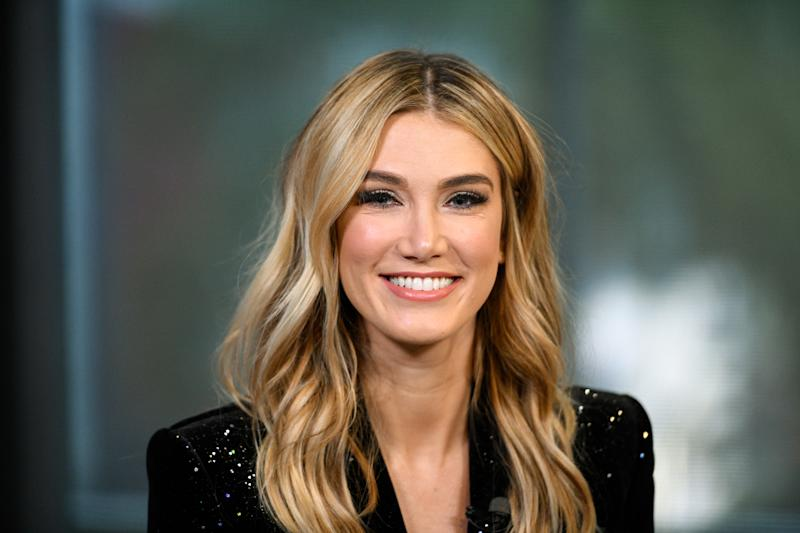 "Delta Goodrem wears a black jacket and her wavy blonde hair loose for an appearance on ""Extra"" at Universal Studios Hollywood on January 31, 2019 in Universal City, California."