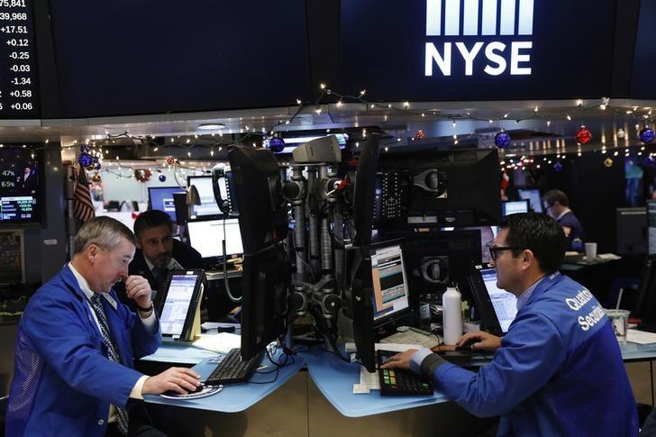Traders work on floor of the New York Stock Exchange (NYSE) shortly before the close of trading in New York,