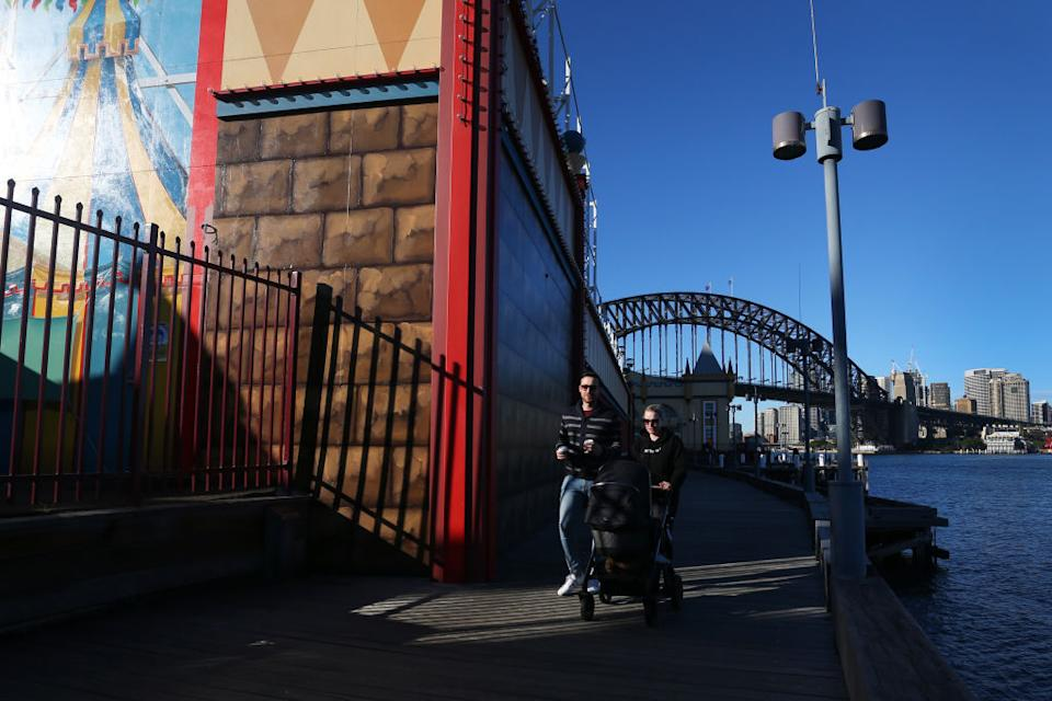 People are seen exercising along the Milsons Point boardwalk in Sydney, Australia.