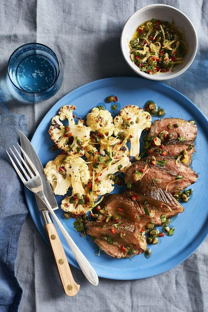 """<p>Spruce up a classic steak dish with this colorful, bursting-with-flavor relish.</p><p><em><a href=""""https://www.womansday.com/food-recipes/food-drinks/recipes/a60517/steak-and-cauliflower-with-caper-relish-recipe/"""" rel=""""nofollow noopener"""" target=""""_blank"""" data-ylk=""""slk:Get the Steak and Cauliflower with Caper Relish recipe."""" class=""""link rapid-noclick-resp"""">Get the Steak and Cauliflower with Caper Relish recipe.</a></em></p>"""