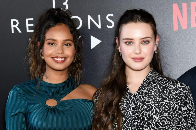 Katherine Langford (R, with Alisha Boe) plays teen Hannah Baker who takes her own life in '13 Reasons Why'