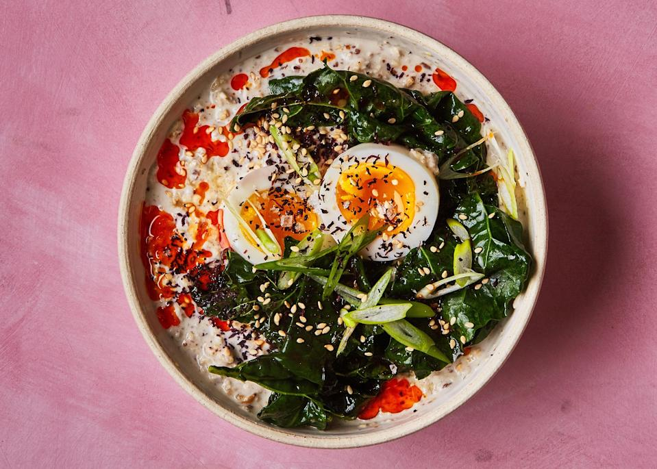 """The components in this recipe sound a little complicated, but trust us. All of them can be made in advance and just need to be warmed before eating. <a href=""""https://www.bonappetit.com/recipe/overnight-oats-with-soft-cooked-egg-and-miso-braised-kale?mbid=synd_yahoo_rss"""" rel=""""nofollow noopener"""" target=""""_blank"""" data-ylk=""""slk:See recipe."""" class=""""link rapid-noclick-resp"""">See recipe.</a>"""