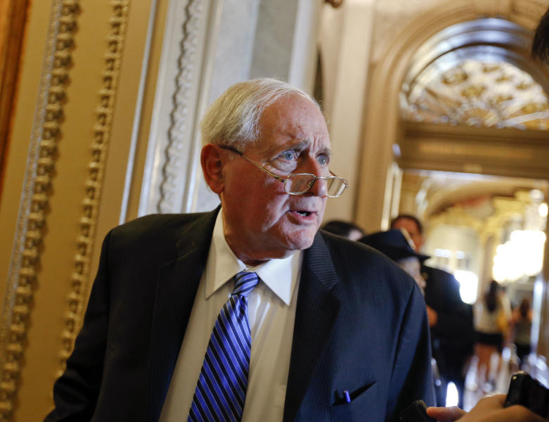 File -In this July 30, 2013, file photo, U.S. Senate Armed Services Committee Chairman Carl Levin, D-Mich., speaks with a reporter outside the Senate chamber at the Capitol in Washington. Levin says he supports President Barack Obama's statement Saturday, Aug. 31, 2013, that he would seek congressional action before responding militarily to the apparent use of poison gas against Syrian civilians. (AP Photo/Scott Applewhite, File)