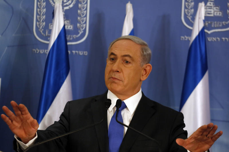 Israeli Prime Minister Benjamin Netanyahu gestures as he speaks during a press conference at the defense ministry in the Israeli coastal city of Tel Aviv on July 11, 2014 (AFP Photo/Gali Tibbon)