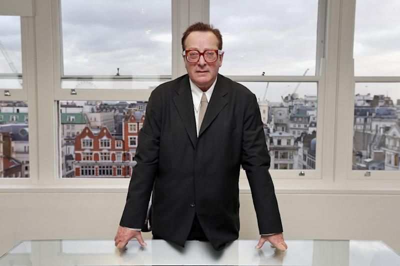 """Lord Maurice Saatchi poses for photos at his office in central London, Monday, Feb. 4, 2013. Saatchi's wife, best-selling Irish novelist Josephine Hart, died from ovarian cancer in 2011, and he describes his wife's cancer treatment as """"medieval"""", and is proposing a parliamentary bill to legalize the ability of doctors to use experimental therapies even if there is no proof they work.  Saatchi acknowledges his bill, aimed at encouraging new therapies and speeding up access to new drugs, is driven by grief for his wife, and that the bill may not make it into law, but he has wide support from numerous members of parliament and he remains hopeful about giving new opportunities to doctors and their patients.(AP Photo/Lefteris Pitarakis)"""