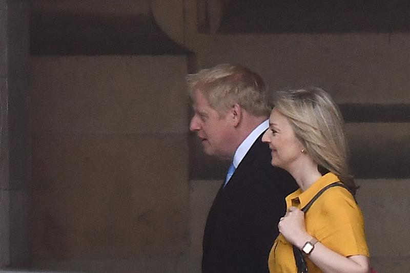Conservative MP and leadership contender Boris Johnson (L) walks with Britain's Chief Secretary to the Treasury Liz Truss (R) at the Houses of Parliament in London on June 20, 2019. - Conservative MPs will decide on June 20 who will join Boris Johnson in the final two battling become Britain's next prime minister, with three contenders jostling for the second spot. (Photo by Ben STANSALL / AFP) (Photo credit should read BEN STANSALL/AFP/Getty Images)