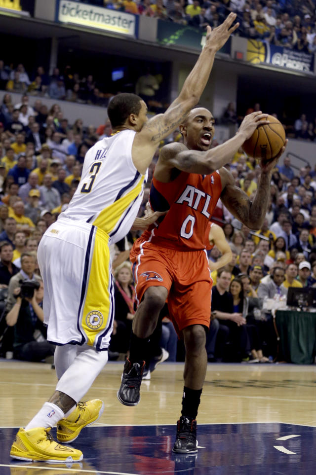 Atlanta Hawks' Jeff Teague (0) drives toward the basket as Indiana Pacers' George Hill (3) defends during the first half in Game 5 of an opening-round NBA basketball playoff series Monday, April 28, 2014, in Indianapolis. (AP Photo/Darron Cummings)